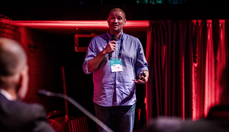 John White speaking at Shift Money where Fractal Won in 2018